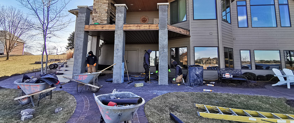 A patio under construction by a home in Gretna, NE.